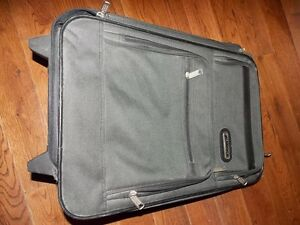 Small size nylon suitcase.