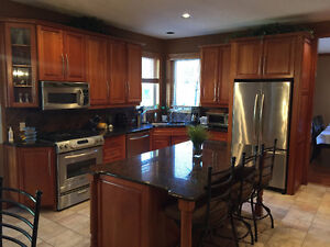 Solid cherry kitchen cabinets, granite counters for sale