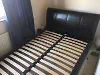 Brown leather look double bed, free delivery.