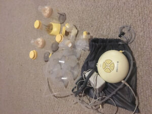 Medela swing breast pump with extra bottles, tubing, attachments