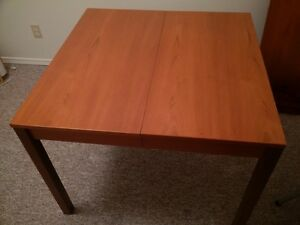 Teak Table with leaf and 4 chairs.