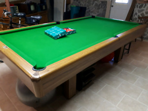 4 1/2 × 9 ft. Snooker table.