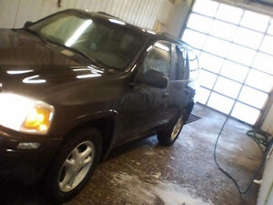 2004 GMC Envoy SUV, 4x4 open to trades. Perfect daily driver