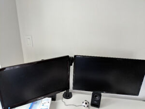 Dual monitor with a stand - $300 (Downtown, Vancouver)