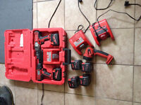13 pieces Milwaukee 18 volts drill and impact set + 6 batteries