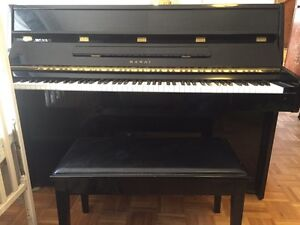 For sale KAWAI piano, black with bench.