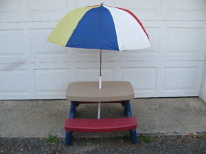 LITTLE TIKES PICNIC TABLE WITH UMBRELLA.