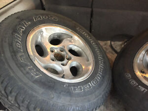 2 ALUMINUM RIMS WITH TIRES FROM 1995 FORD EXPLORER