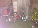 Red child bike for sale