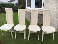 4 cream faux leather dining chairs