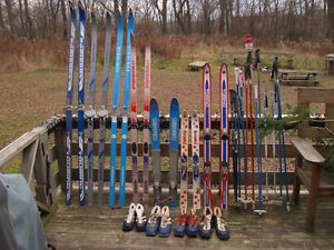 Assorted Used Cross Country Skis, Poles, and Boots