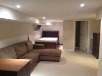 Clean, bright and spacious basement apartment - furnished