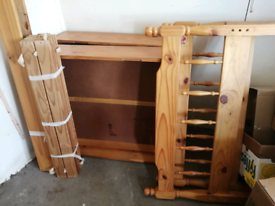 Single wooden bed with storage drawers