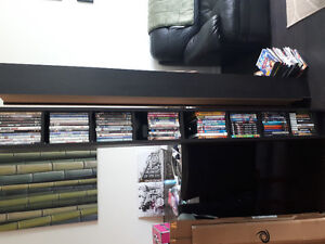 Sell (2) 6-foot tall DVD or book stands