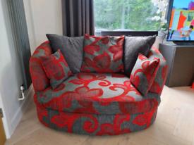 Swivel cuddler sofa