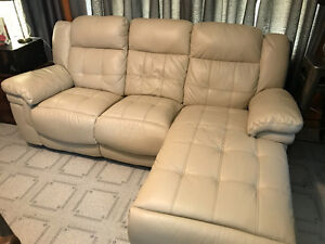 Reclining couch with chaise lounge seat