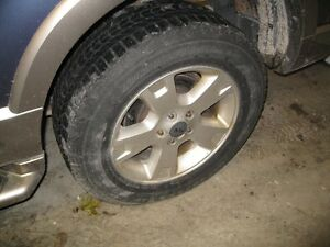 Ford Explorer aluminum rims and tires London Ontario image 2