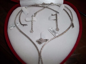 REDUCED TO SELL IS THIS BEAUTIFUL 18K DIAMOND JEWLERY SET(CASH)