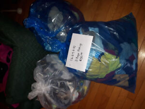 Bags of baby boy clothes