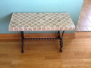 Wrought iron table with tile top.