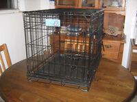Double door dog crate almost new