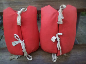 pair of antique life jackets