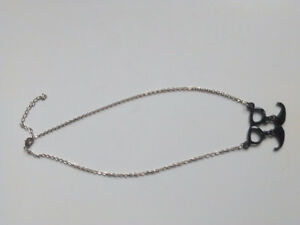 SILVER PLATED NECKLACE WITH BLACK EYEGLASS/ MOUSTACHE PENDANT