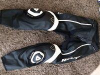 Ladies Revit racer biker leathers. Black and whote