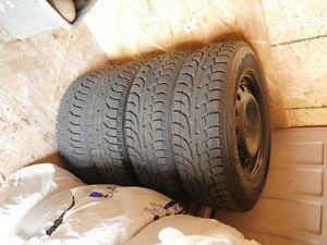 Set of 4 winter tires on steel rims (5x100) Excellent condition!