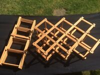 Two folding wooden wine racks