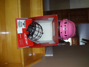 Casque hockey-patins fille moyen 54-58 cm comme neuf