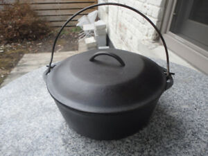 VINTAGE CAST IRON LODGE DUTCH OVEN (cleaned and seasoned )