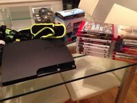 PS3 320GB Slim + 2 Manettes + PS Move + Guitar Hero World Tour