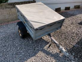 4FT x 3FT covered trailer.