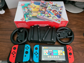 Nintendo Switch with original box, 4 games, 4 controllers, and more