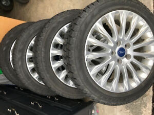 (4) 215-50-R17 winter tires and rims like new