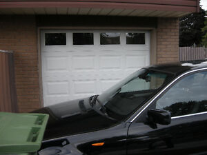 CLOPAY GARAGE DOOR 8FT W BY 7FT H WITH WINDOW ON TOP
