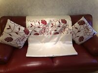 Cream and red curtains and 4 cushions