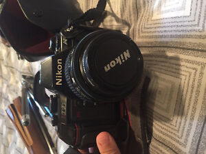 Nikon N2020 AF camera with short and long lens, tripod and flash