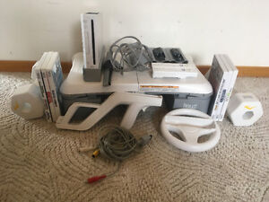Wii system and all accessories and 6 games seen in picture