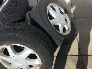 Nissan rims and tires off Versa