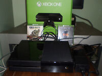 Xbox One with controller and the games Halo: MCC and COD AW