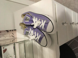 Brand new in box purple women's converse shoes. Size 8.5.