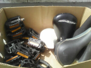 Box of bike pedals and seats