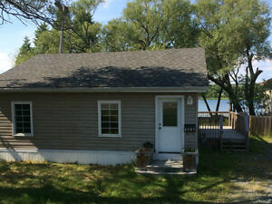 Lake view Waterfront Bungalow in minowlake for sale$210,900.00