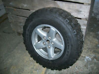 BRAND NEW HERCULES TRAIL DIGGER TIRE AND RIM