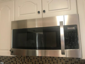 Stainless steel over the range microwave oven with fan