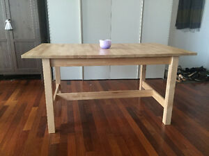 Expandable IKEA wooden dining table