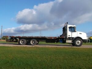 Volvo with 29 ft Hyd Tilt Deck