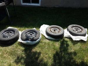 4 winter tires plus rims (Chevy cobalt)